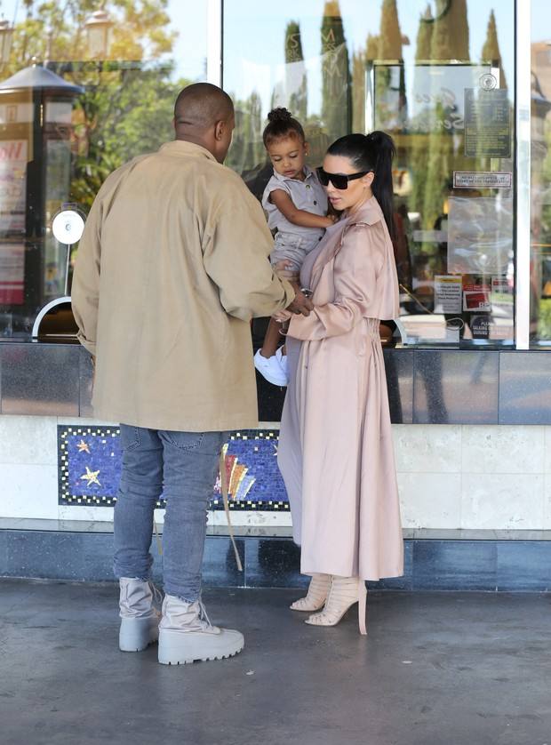 Family: Kim Kardashian and Kanye West lead to daughter, North West, cinema