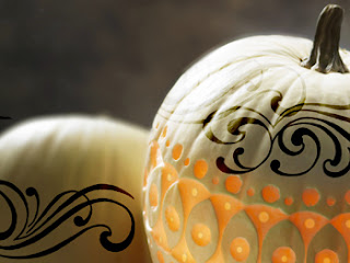 white carved pumpkin with black detail design