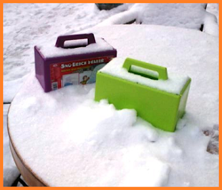 2 snow brick molds: one green, one purple