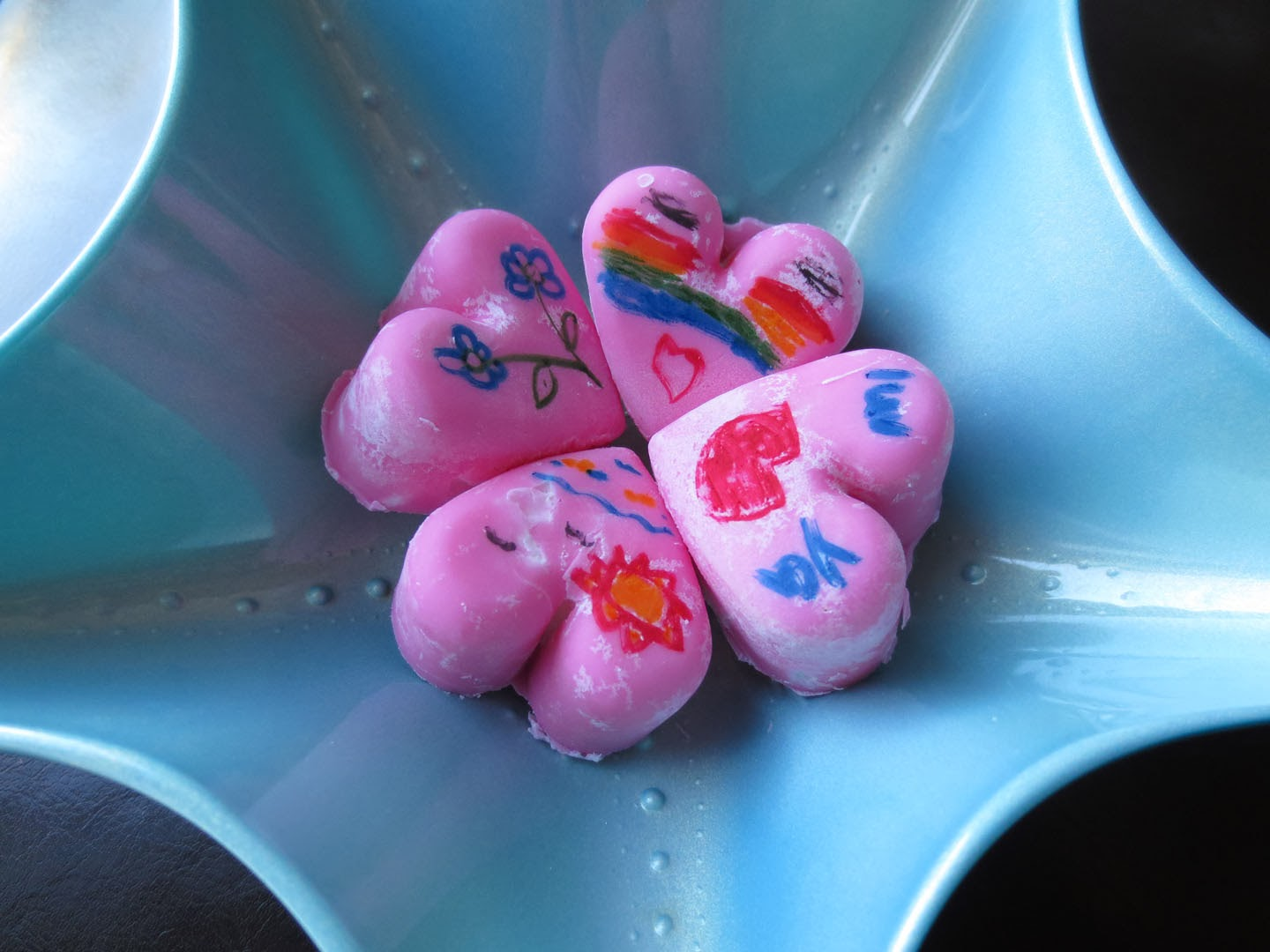 chocolate hearts decorated with colorful pens