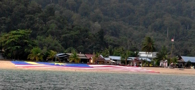 Huge flag on Tekek Beach, Merdeka (Independence) Day at Tekek on Tioman Island Malaysia