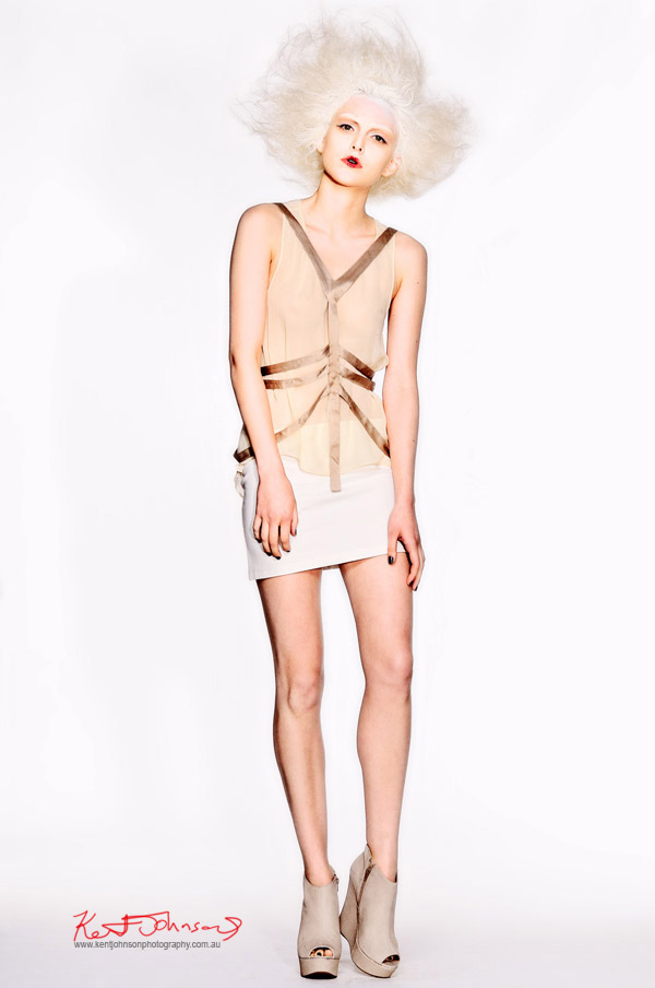 Uscari 'Submerged in Silence'  tight white skirt and sheer gold top on white background;  Photographers Edit