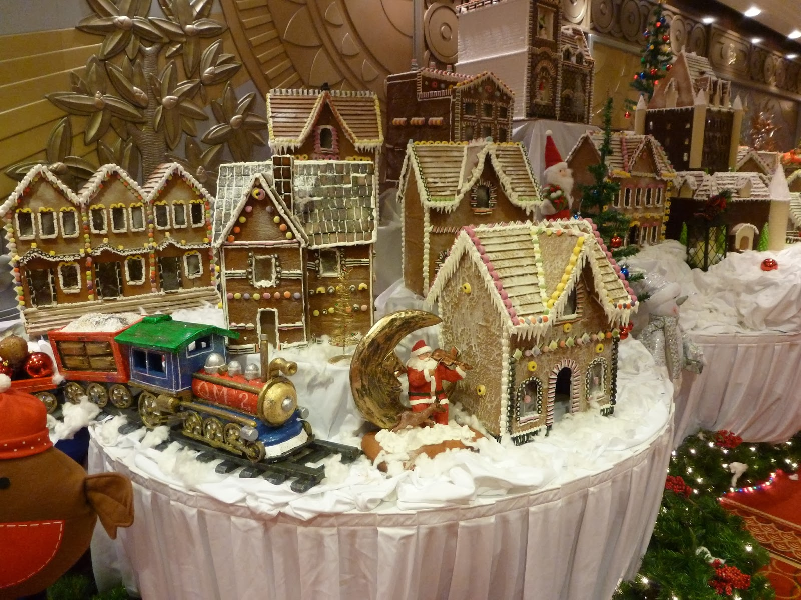 the christmas decorations looked lovely and there was a spectacular gingerbread village in the central walkway - Queen Christmas Decorations