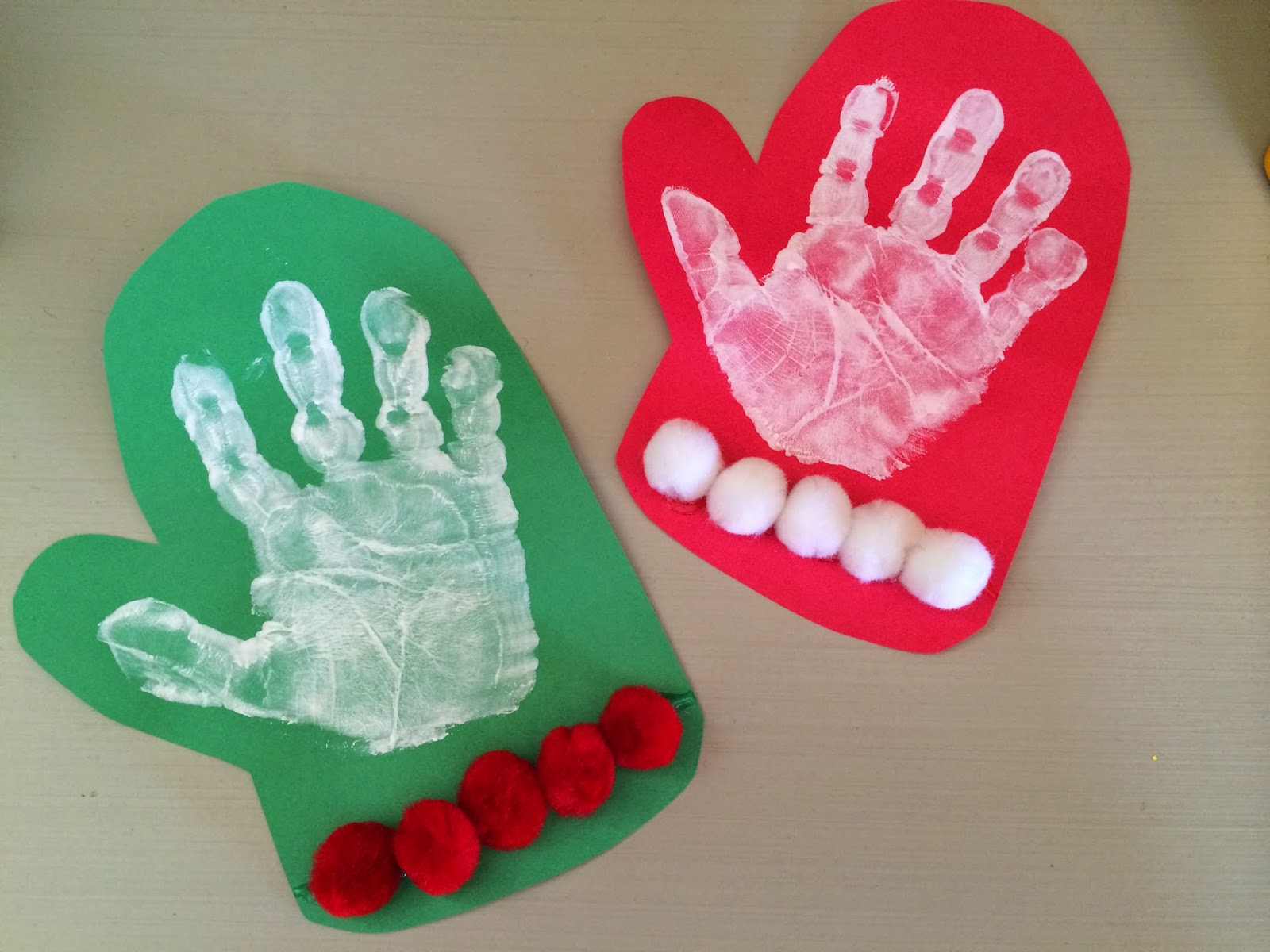 ... paper. Do a white paint handprint & let dry. Add pom poms