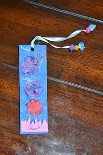 http://123mytoddlerandme.blogspot.ca/2010/12/easy-gift-for-toddler-to-make-bookmarks.html