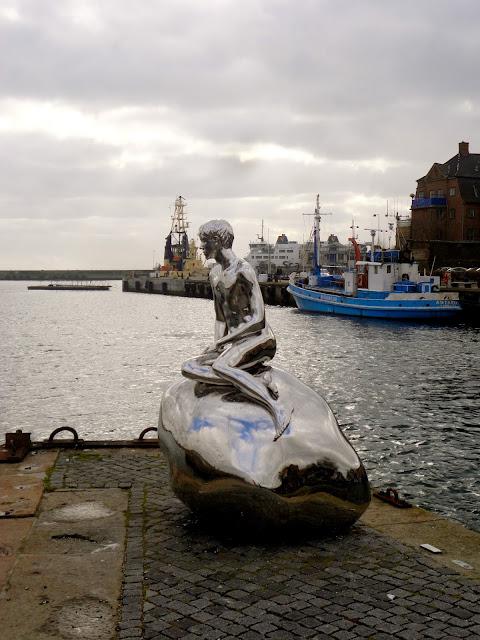 Silver boy statue at Helsingor, Copenhagen, Denmark
