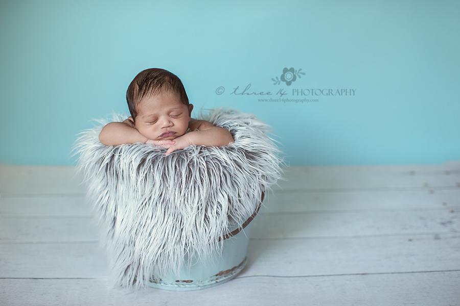 Newborn-Baby-In-Blue-Water-Bucket
