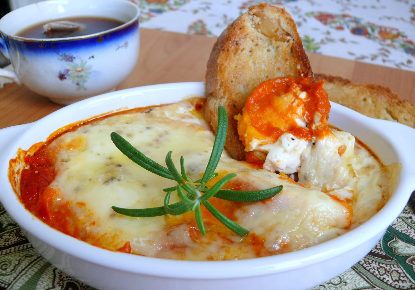 ... of Little Pleasures: Baked Eggs in Roasted Pepper and Tomato Sauce