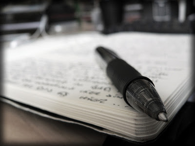 Image of a pen on a notebook