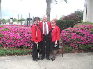 Laurel, Rev. Thompson and Miss Anna Lee outside of Grace Church