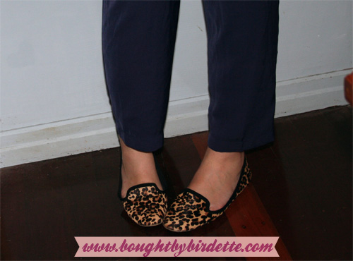 leopard print shoes, navy trousers