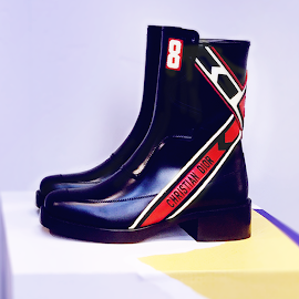 Christian Dior red striped, leather boots.