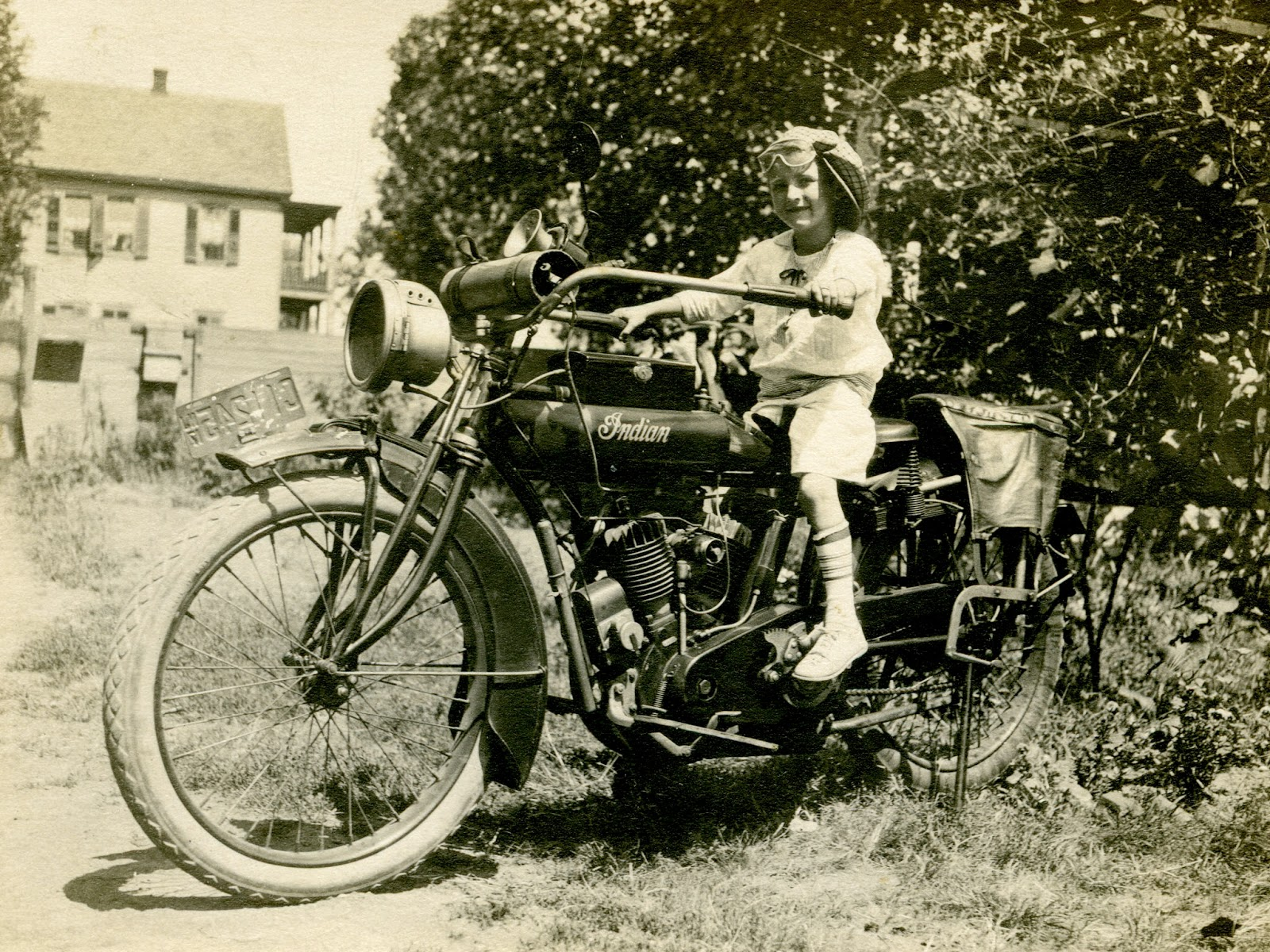 Little Girl Sitting On An Indian Motorcycle With 1917 New