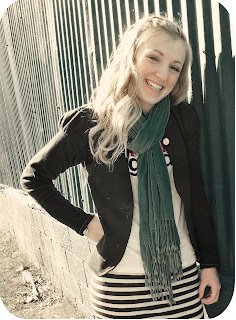blonde girl in black and white striped shirt with black cardigan and scarf