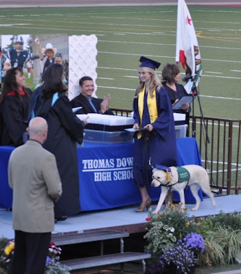 Amber May and yellow Lab pup Cloe in cap and gown