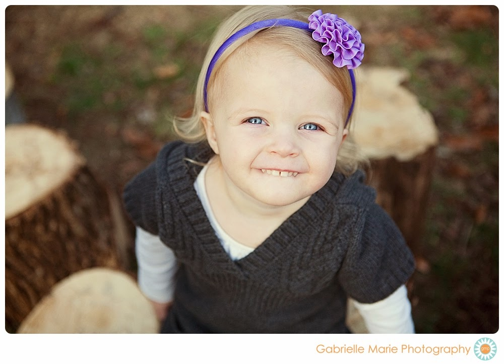 Young girl with blue eyes and purple headband smiles big - Best of 2013 Family Portraits in Fenton, MO