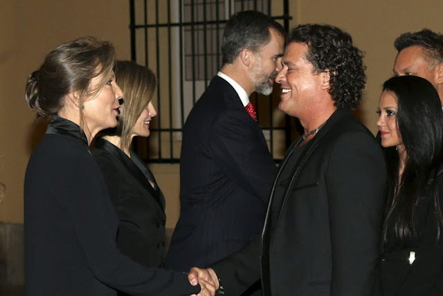 Colombian singer Carlos Vives greets Maria Clemencia Rodriguez, wife of Colombian President Juan Manuel Santos next to Spanish King's Felipe VI and Queen Letizia during the official reception of a dinner held at El Pardo Palace in Madrid, Spain