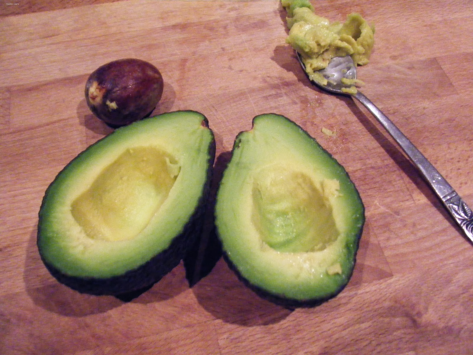 avocado flesh sliced on chopping board