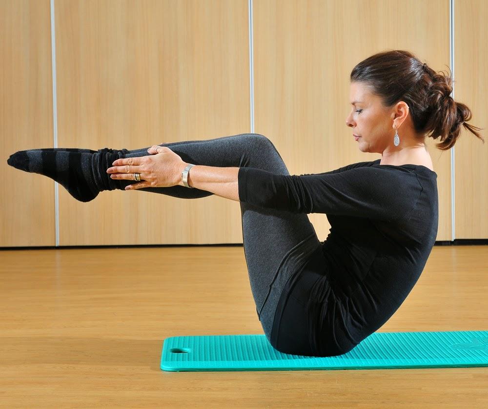 Pilates holidays instructor exercising in Pilates studio