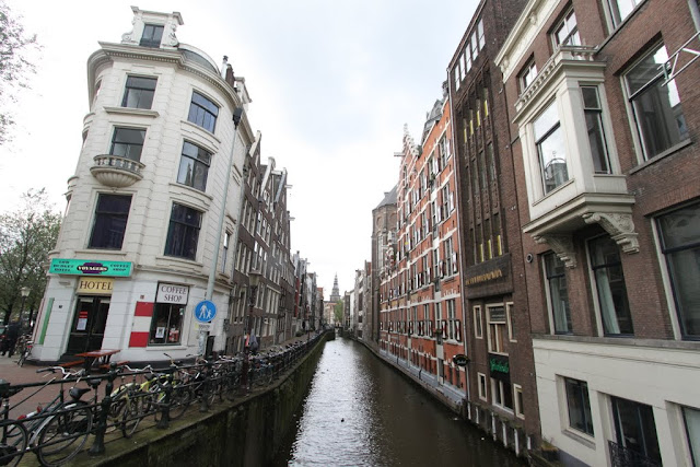 A canal with surrounded by beautiful architectural buildings in Amsterdam, Netherlands