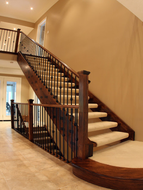 Traditional Staircase by Schnarr Craftsmen Inc