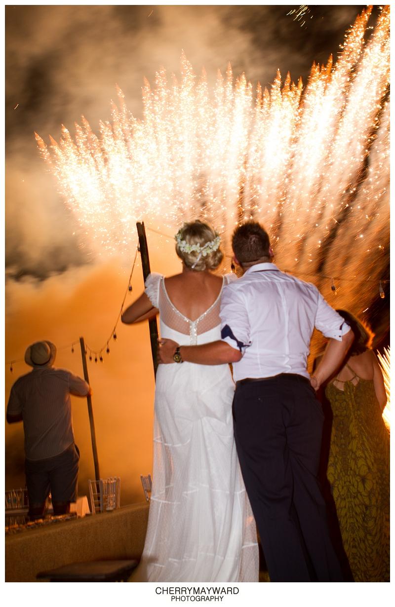 Bride and groom watching fireworks at Koh Samui, Thailand Destination wedding