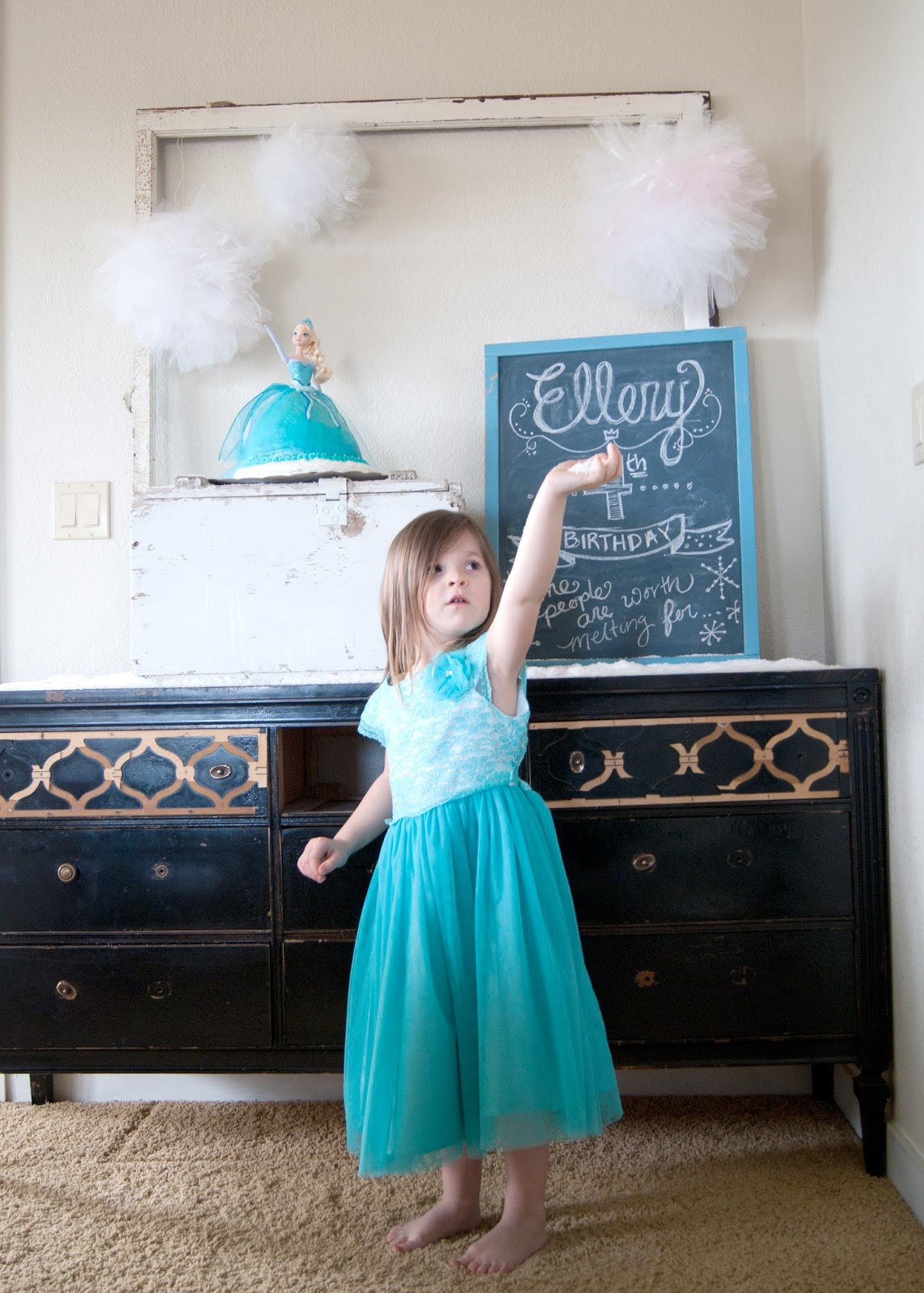 The birthday girl and the party decor - Frozen themed birthday party