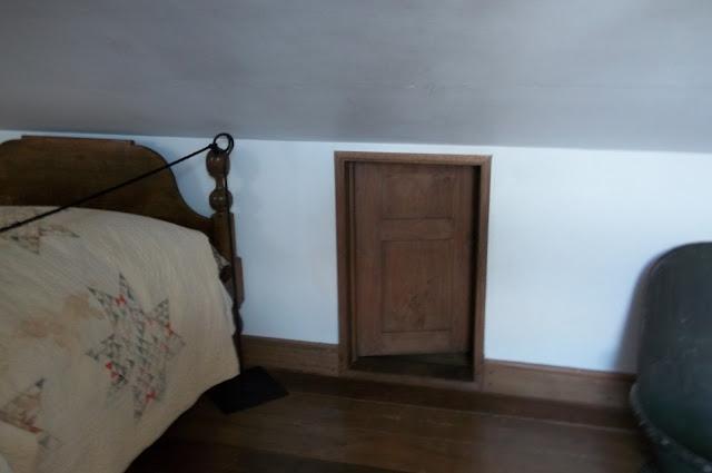 Underground Railroad = Secret attic access slide bed over to hide the door.