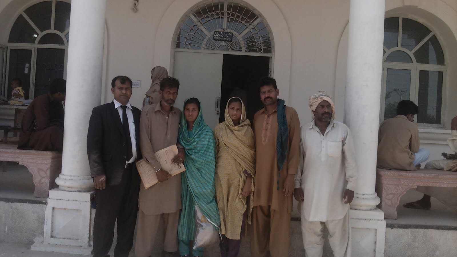 Sardar Mushtaq Gill,Human Rights Lawyer along with raped victims at Trial Court Jaranwala