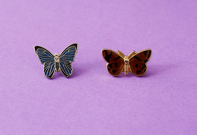 vintage butterfly brooches on purple background