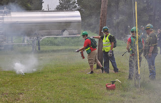 Security Studies students fight a fire as part of a CERT exercise.