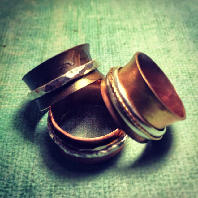 Copper spinner rings with key embossing and silver spinners