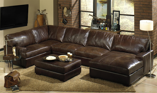 glamorous dark brown distressed leather sofa with small leather table and brown carpet
