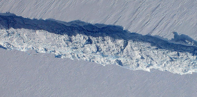 View of the Pine Island Glacier rift seen from the Digital Mapping System camera aboard NASA's DC-8 on Oct. 26, 2011. Image Credit: NASA / DMS