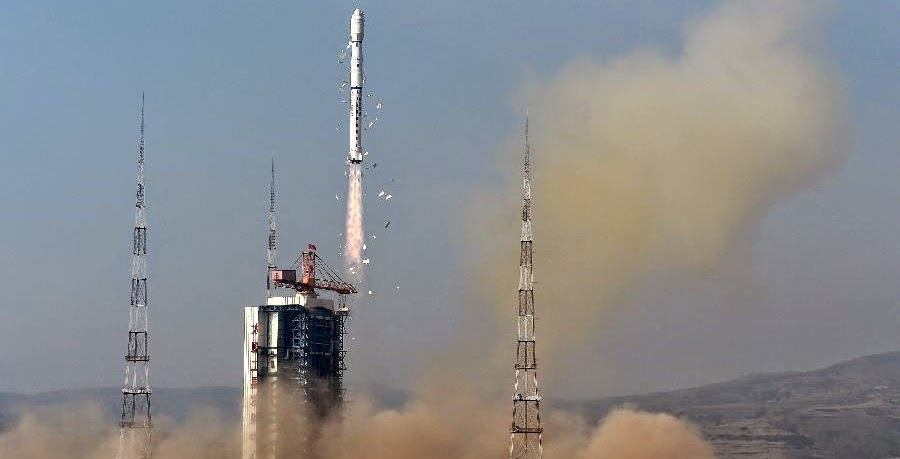 A Long March-4B rocket carrying the Yaogan-26 remote sensing satellite blasts off from the launch pad at the Taiyuan Satellite Launch Center in Taiyuan, capital of north China's Shanxi Province, Dec. 27, 2014. Credit: Xinhua/Yan Yan