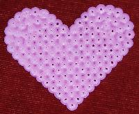 Hama beads pink heart.