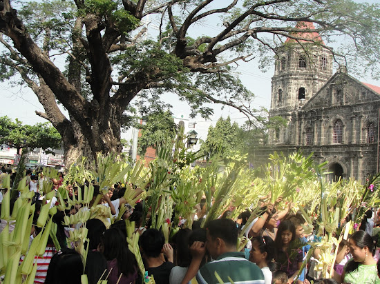 Filipinos celebrating Linggo ng Palaspas or Palm Sunday.
