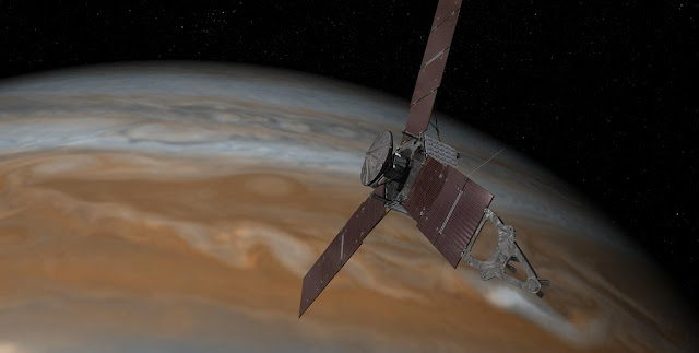 This artist's rendering shows NASA's Juno spacecraft making one of its close passes over Jupiter. Credits: NASA/JPL-Caltech