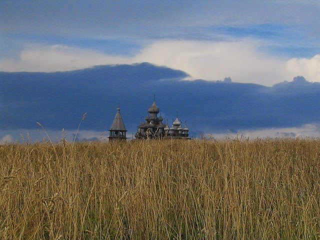Picture of a wheat field with Russian Orthodox church in background