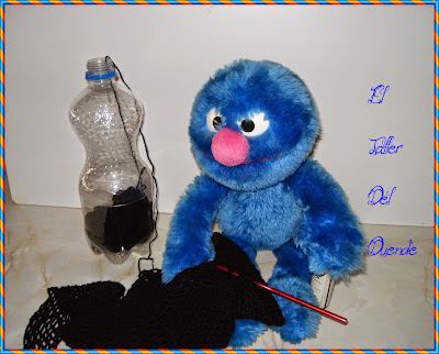 http://eltallerdelduende.blogspot.com/2014/01/guarda-lanas-pet.html