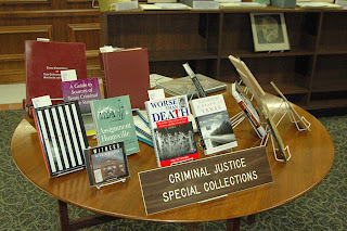 A small portion of the criminal justice collection in the Thomason Room.