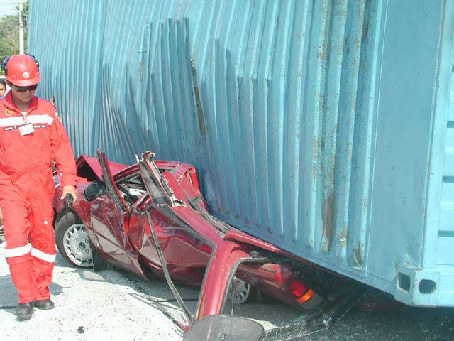 Car and one man under container