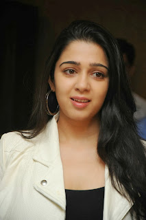 Actress Charmi Kaur Pictures in Jeans at One by Two Movie Celetes 20 Years Event 0001