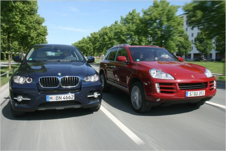 porsche cayenne turbo vs bmw x6 xdrive50i