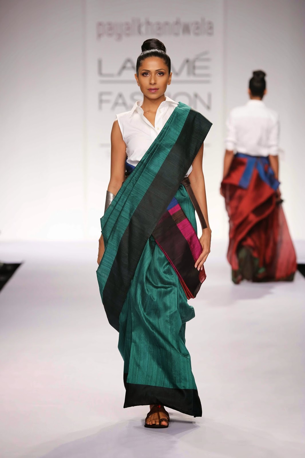 "Aimed at the bold uninhabited sensuous elegant woman, Payal Khandwala's collection called ""A Perfect Fit"" was totally apt for the Lakmé Fashion Week Summer/Resort 2014 season. Drawing inspiration from men's wear, the creations had feminine elements but keeping them in the neutral category."