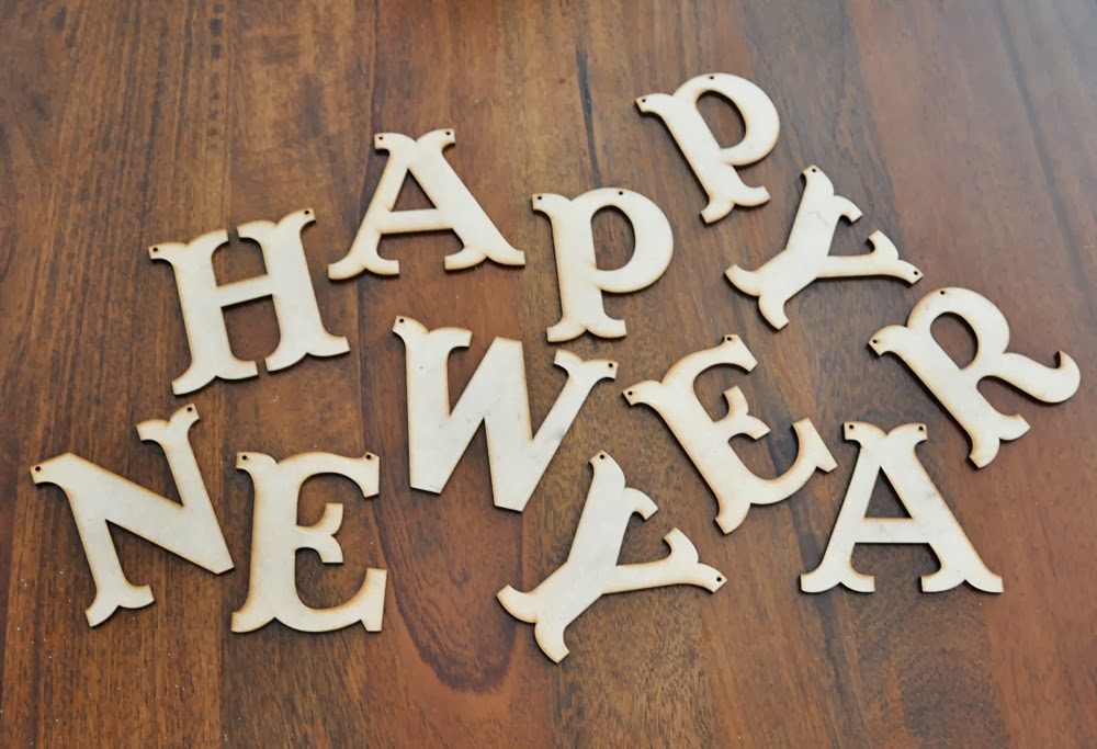 first i started with this diy wooden happy new year banner kit from say hello