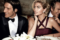 Kate Upton in a glamorous dress at dinner table