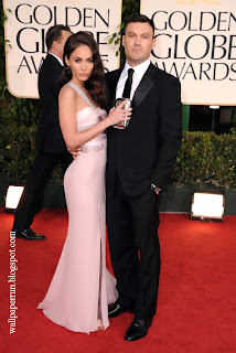 Actors Megan Fox and Brian Austin Green arrive at the 68th Annual Golden Globe Awards
