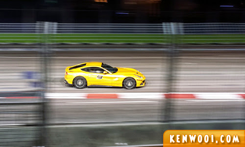 yellow ferrari on track
