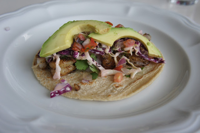 Shrimp taco with slaw, pico de gallo, and avocado